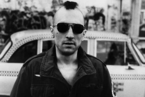 Robert De Niro in Taxi Driver with Mohawk hair standing in front of taxi cab 11x17 Mini Poster