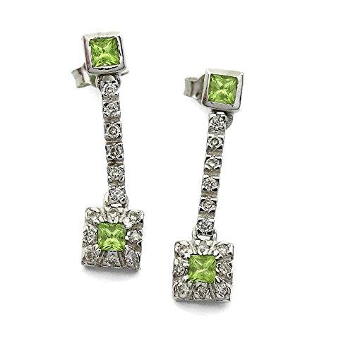 Pendientes de 0.45cts de diamantes y piedra fina de color en oro blanco de 18Ktes. Never say never