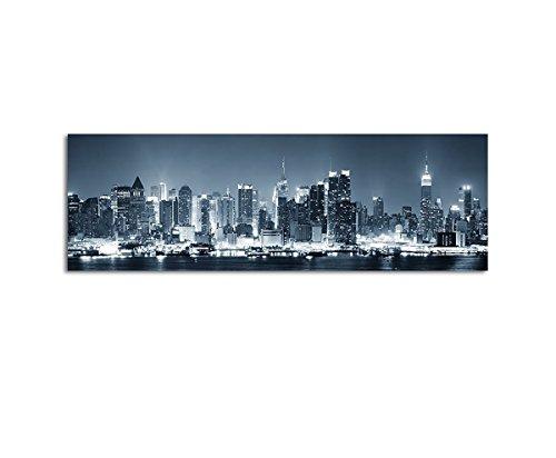 Wandbild Panorama New York City Manhattan Skyline schwarz weiss blau in der Nacht auf Leinwand und Keilrahmen. Beste Qualität, handgefertigt in Deutschland! 150x50cm
