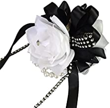 white rose boutonniere with black ribbon
