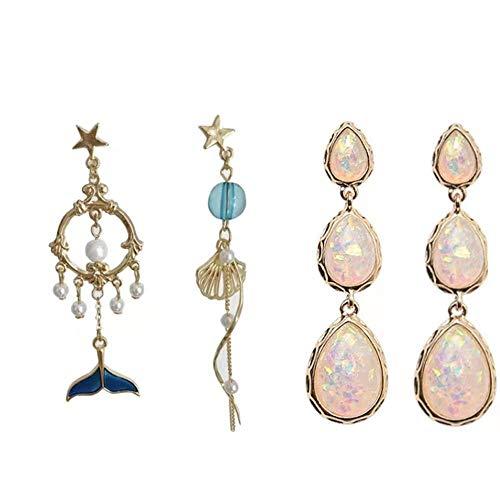 Combinazione di abbinamento: orecchini asimmetrici di balena blu e orecchini colorati con gocce d'acqua.