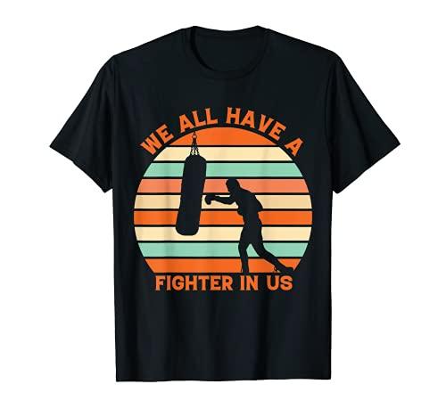 Todos tenemos un luchador en nosotros Retro Camiseta