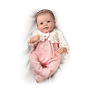 'Sadie' Interactive Baby Doll by Master Artist Linda Murray that breathes, coos and has a heartbeat, exclusively from The Ashton-Drake Galleries This little darling is fully poseable and has RealTouch skin that is so soft to the touch Weighted to fee...