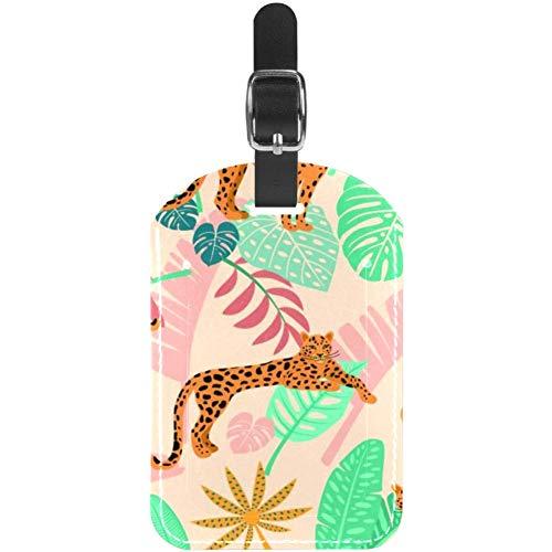 Etiquetas de equipaje de piel con diseño de leopardo africano con hojas...