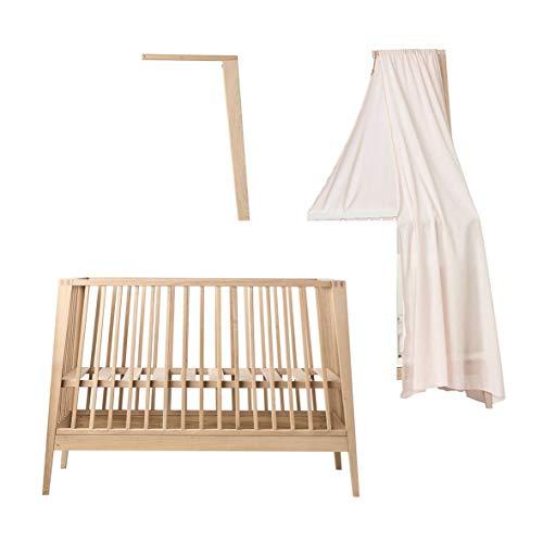 Linea - Cuna de madera de roble con dosel y dosel de color rosa pálido sin colchón.