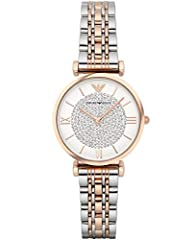 Rose gold-tone watch featuring white dial with logo 12 o'clock hour marker and blanket of round crystals at center 32 mm stainless steel case with mineral dial window Quartz movement with analog display Two-tone stainless steel bracelet with deployan...