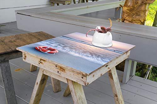 Wallario Aufkleber Selbstklebende Garten-Tisch-Decke - Rettungsring am Strand bei Sonnenuntergang in 90 x 90 cm