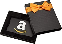 an elegant black and gold gift box containing a gift card