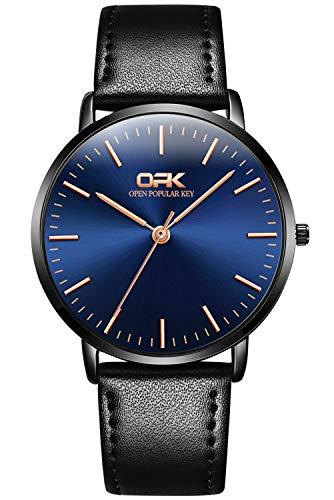 Reloj analógico de cuarzo con correa de piel negra.