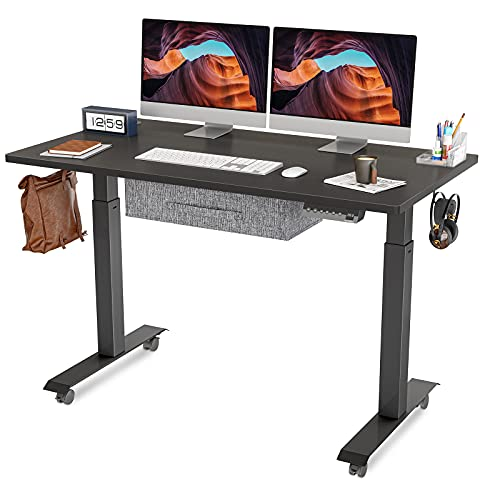 FEZIBO Electric Height Adjustable Standing Desk with Drawer, 48 x 24 Inches Splice Board, Black Frame/Black Top