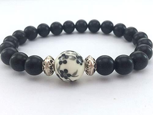Bracciale zen da donna, perle di agata con perla centrale in porcellana stampata.