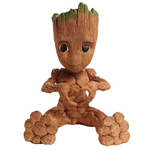 Groot planter making a heart with his hands
