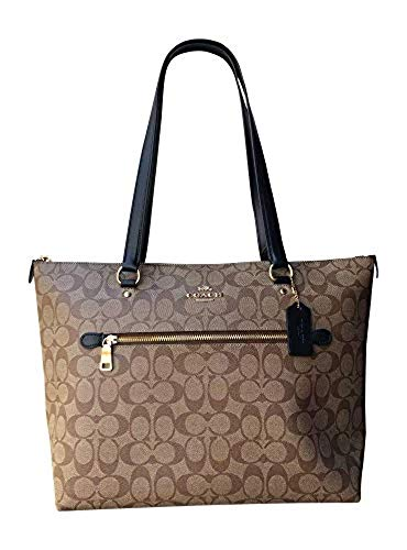 """Signature coated canvas and leather trim with gold tone hardware Exterior zip pocket; handles with 10.25"""" drop Raised Coach logo on front Interior features fabric lining with one zip pocket and two multifunction slip pockets; Coach leather license wi..."""