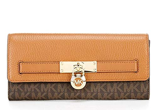 """MK Logo Coated Canvas and Pebbled Leather Flap Closure Secured with Hidden Snap Exterior: 1 slip pocket, Iconic MK Gold Lock Charm 1 interior zip pocket, 4 slip pockets & 14 credit card slots 7-3/4""""W x 4""""H x 1-1/2""""D"""