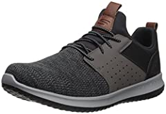 Instant sporty style and lightweight comfort delivers in the SKECHERS® Delson - Camben shoe! Slip on laced-front sporty casual comfort sneaker design. Soft lightweight knit-mesh fabric upper. Soft fabric shoe lining. Smooth leather-textured synthetic...