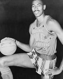 1959 photo Wilt Chamberlain, three-quarter length portrait, wearing uniform of Harlem Globetrotters basketball team / Worl...