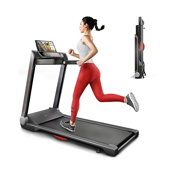 woman in red jogging bottoms running on a treadmill