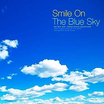 파란 하늘에 미소를 담아