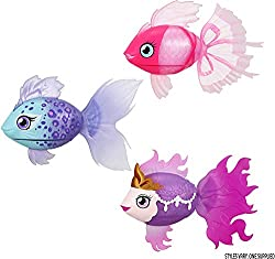 Styles vary, one supplied at random. Pack magically opens to reveal your fish! Lil' Dippers magically swim around in water. Lifelike movements - swims up-and-down, plus side-to-side. 3 cute characters to collect. Includes magnetic fish feeder & demon...
