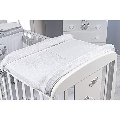 Plan à langer pour lit bébé en plexiglas.