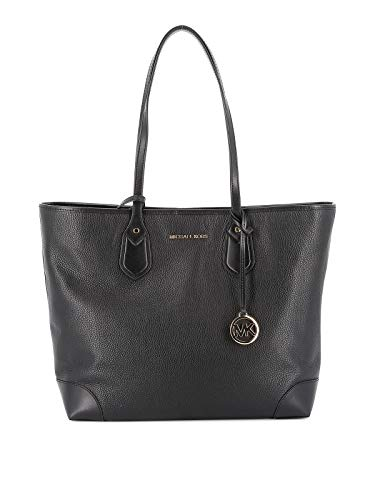 Magnetic closure A main compartment with interior zipper and slip pockets Logo on the front