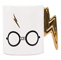 """Officially licensed Harry Potter merchandise by Half Moon Bay The design features Harry Potter's glasses and the words, """"The Boy Who Lived"""" Mug handle shaped like Harry's lightning bolt scar Includes gold detailing Not dishwasher or microwave safe"""