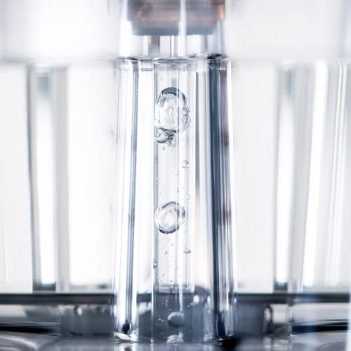 The glass tube with boiling water