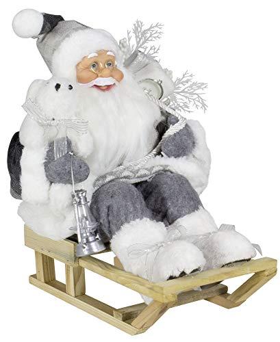 Christmas Paradise Deko Weihnachtmann auf Schlitten Santa Nikolaus Größe 45cm Grau-Weiß