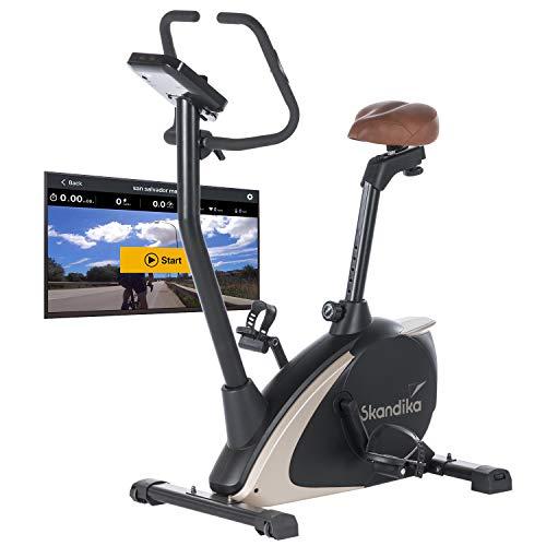 Skandika Ergometer Vinneren Design Hometrainer | Fitness Fahrrad mit Magnetbremssystem, 11kg Schwungmasse, 12 Trainingsprogramme, Tablet-Halterung, Bluetooth und App-Steuerung | schwarz/gold