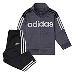 The updated tricot set features a full-zip jacket with 3 sleeve piecings, applied 3 stripes in two colors, and welt pockets. Screen printed Adidas core brand mark at front chest. Boys 2-piece tracksuit is en essential playwear set. Easy to wear, wash...