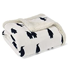 Ultra plush fleece reverses to cozy Sherpa Machine wash, cold, do not bleach, tumble dry, gentle, low heat, iron, low Includes 1 throw Dimensions: 50x60in