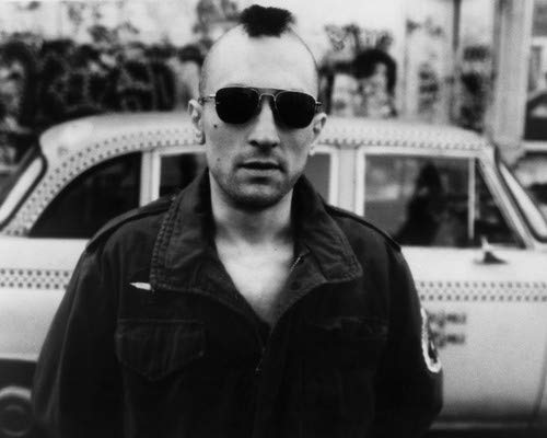 Taxi Driver Robert De Niro with Mohawk hair standing by taxi cab 8x10 Promotional Photograph