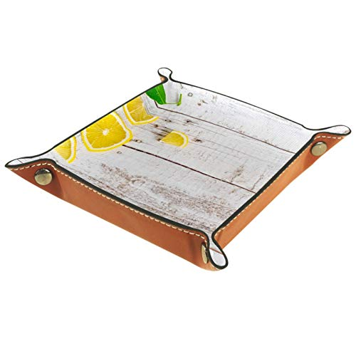 Caja de almacenamiento pequeña, bandeja de valet para hombre,Limón orgánico y rebanadas con hoja en mesa de madera. ,Organizador de cuero para llaves de caja de monedas