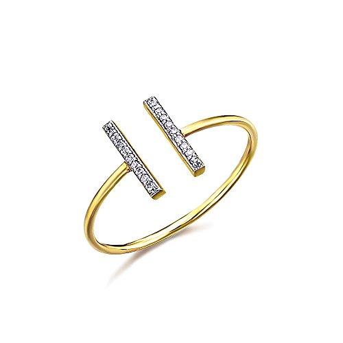 Anillo fino semiabierto, con dos barras en la parte superior cubiertas de diamantes. Fabricado en Oro 18k, de LECARRÉ JOYAS.