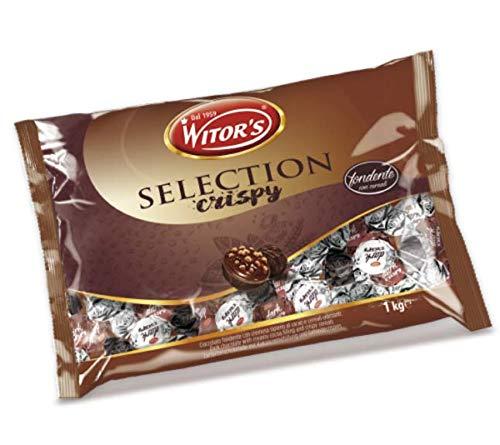 Chocolates de chocolate con leche rellenos de avellana y cereales crujientes.