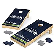 Two regulation sized boards with a solid poplar wood surface and a New Zealand pine wooden frame, plus eight 16-ounce, official sized cornhole bags - this heavy corn hole bean bag toss game set is the genuine article. Seattle Seahawks football fans r...