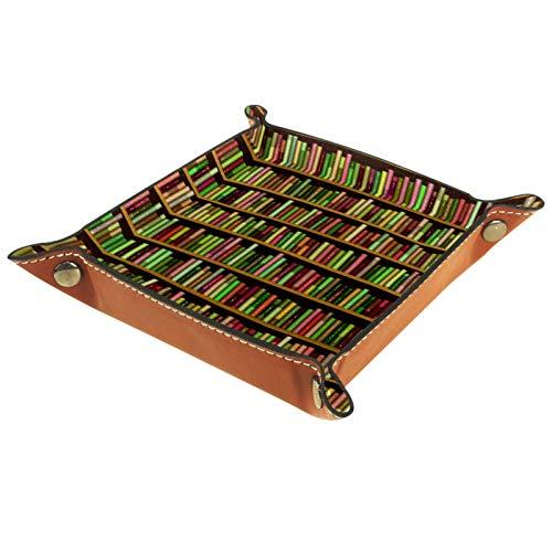 Caja de almacenamiento pequeña, bandeja de valet para hombre,Librería llena de libros de diferentes colores. ,Organizador de cuero para llaves de caja de monedas