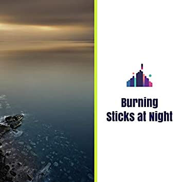 Burning Sticks at Night
