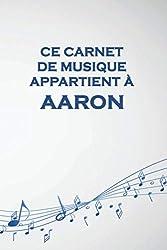 Ce carnet de musique appartient à Aaron: Cahier de partitions: Papier manuscrit / 12 portées par page / idée cadeau (French Edition)