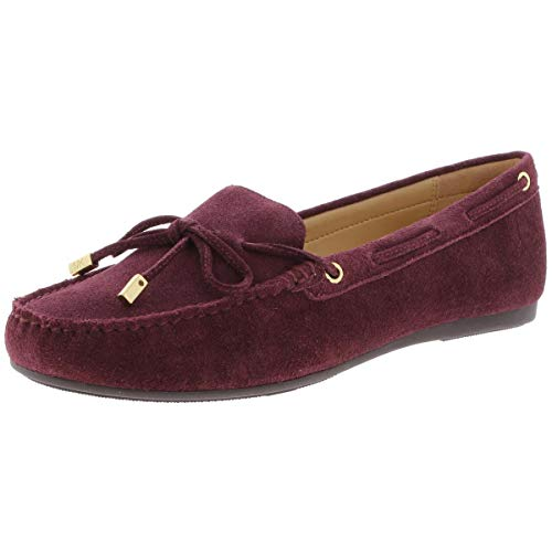 Round-toe slip-on mocassins Laces with grommet detail along topline Bow detail at toe with metallic hardware