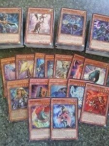 Konami 10 Yugioh Cards - Guaranteed 2 RARES/HOLOGRAPHICS - Chance At Blue Eyes White Dragon, Blue Eyes Ultimate Dragon, & Blue Eyes Shining Dragon by