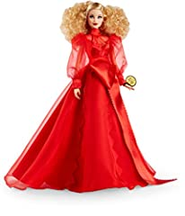 Her voluminous blonde curls are pulled back, accentuating golden hoop earrings and a bold red lip Barbie celebrates Mattel's 75th anniversary with elegance, glamor and an inspired design Dressed in a flowing, red chiffon gown with an intricate serrat...