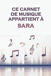 Ce carnet de musique appartient à Sara: Cahier de partitions: Papier manuscrit / 12 portées par page / idée cadeau