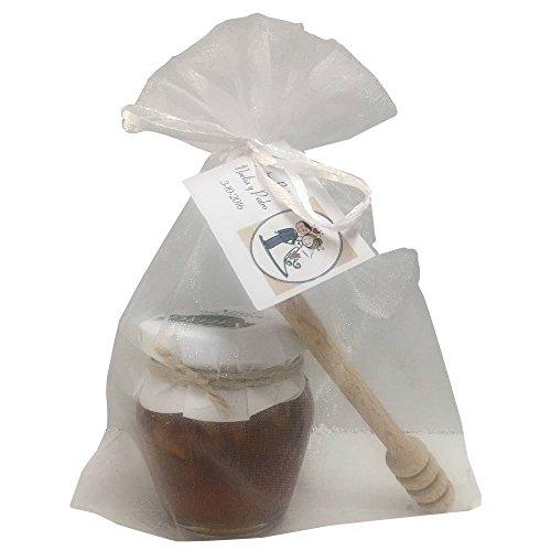 Detalle de tarro de miel con nueces acompañado de palito catador en bolsa de organza (Pack 24 ud)