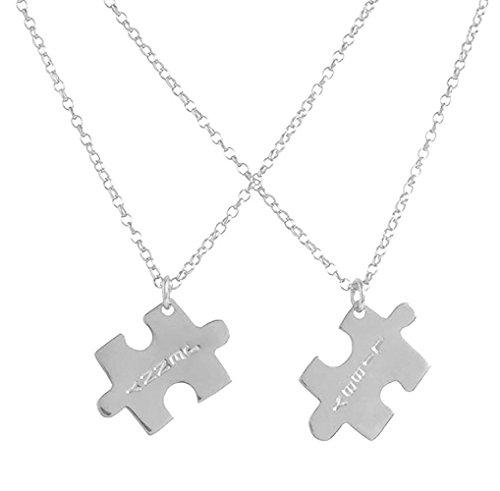 Dos colgantes puzzle personalizados de plata esterlina.