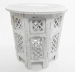 Beautifully hand carved design, individually sold The tables are very easy to assemble just fold out the base and slot the top and bottom together It has carving on the top of the table and the base/legs are covered with MDF Jali design carving Measu...
