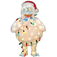 Officially licensed Rudolph the Red-Nosed Reindeer yard decoration Fun and festive statue features a classic Bumble wrapped in Christmas lights and wearing a Santa hat Constructed of a durable steel frame covered in a soft and colorful fabric for a w...