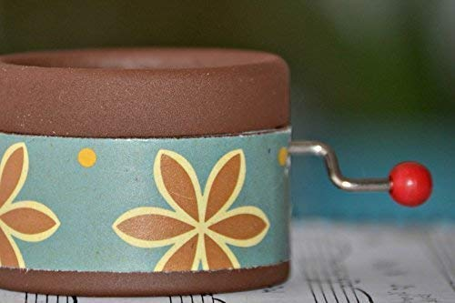 Hand Cranked brown music box decorated with a retro design and the melody My way