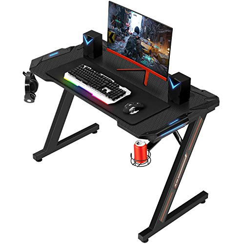 """Sedeta Gaming Desk, 44.5"""" Gaming Table, Ergonomic Z-Shaped PC Gamer Tables, Computer Racing Gaming Desk with Carbon Fiber Surface LED Lights Cup Holder Headphone Hook Mouse Pad Home Office Desk"""