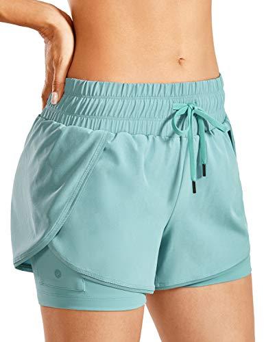 CRZ YOGA Pantalones cortos deportivos 2 en 1 con forro para mujer, con bolsillo con cremallera, 7,6 cm, Azul gris claro., XS